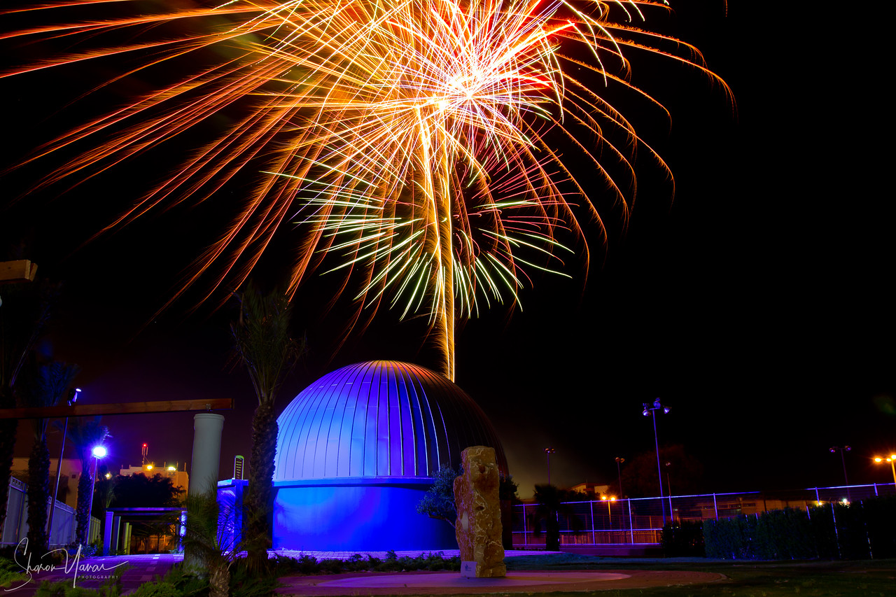 Fireworks over the new planetarium at the science park of Kiryat Yam, Israel