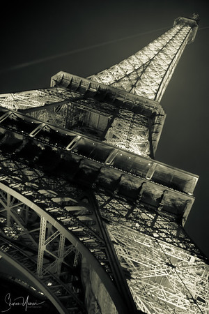 Closer look at night over the Eiffel Tower, Paris, France