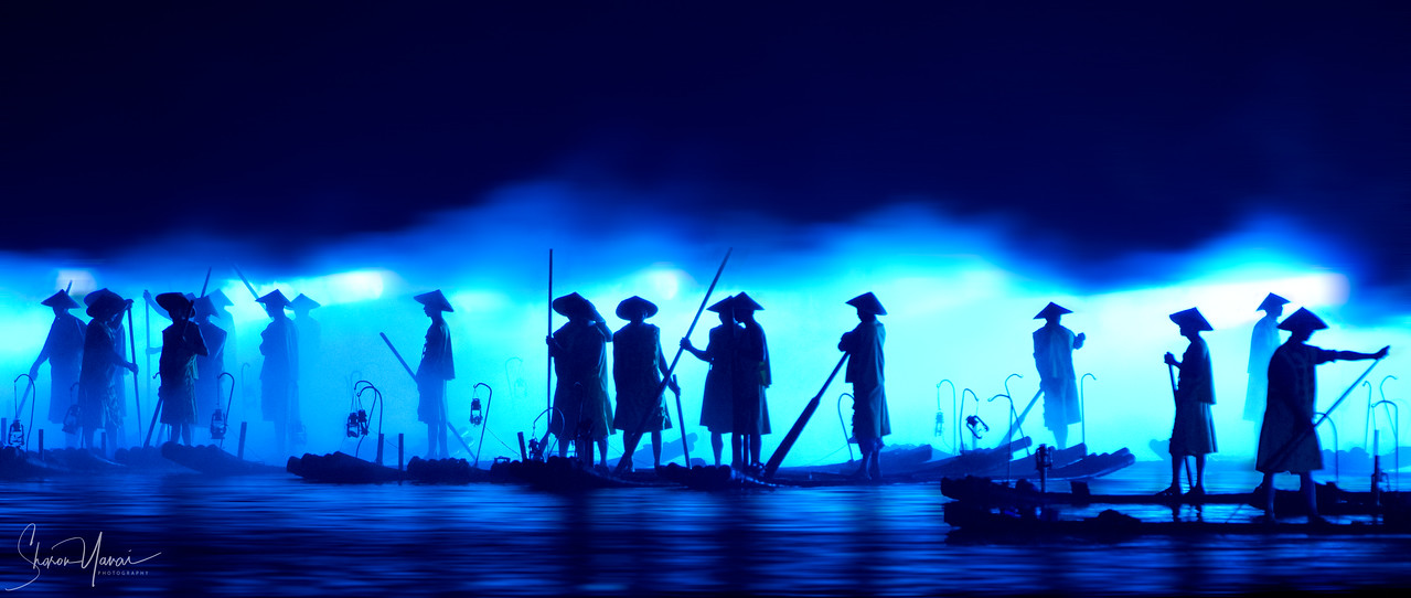 Chinese Fishermen at night with background blue fog