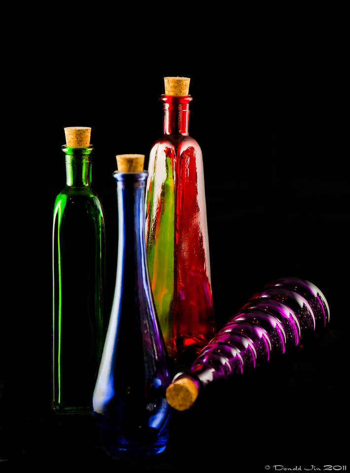 Day 172: Composition<br /> Just messing around with these bottles looking at lighting and composition.  I applied a similar concept for posing people to these bottles by creating difference in height, interesting lines and triangles.  Balancing just the right amount of depth of field while maintaining the necessary shutter speed was bit of a challenge
