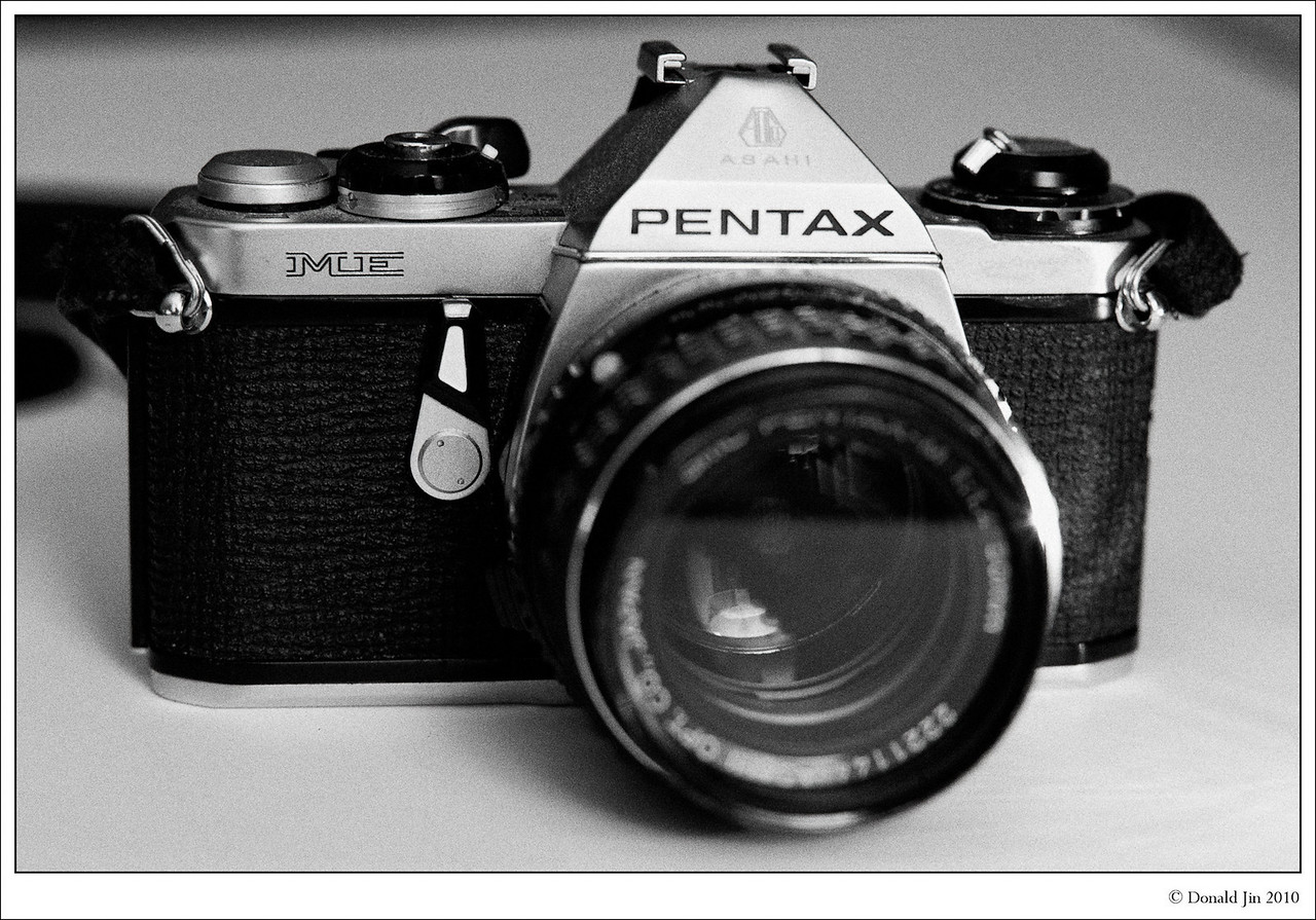 "Day 38:  Well balanced, Quite Matured with a Lovely Bouquet<br /> This is my father's old camera.  He must have bought this back in the late 70's.  This camera was considered a low to mid tiered model in the Pentax line-up.  The camera is fully automatic with only an aperture priority mode and no speed dial and the resulting shutter speed is displayed in the viewfinder.  The body feels extremely solid and well balanced with all metal construction and sits very nicely in the hand.  He owned one lens with this camera and that's the 50mm f/1.4, what is now often referred to as the ""nifty fifty.""  Coincidentally, this photo was made with Canon's version of the same lens.  Though the Pentax ME wasn't the most expensive camera in the line-up, I know this must have been a major investment for him.  My mom told me how he loved taking photos even when they were dating.  I seldom use this camera to take photos, but I have it out on my desk all the time.  I often find myself holding it in my hands, feeling the cold metallic body, pressing the shutter few times and even putting it up to my nose to appreciate its bouquet."
