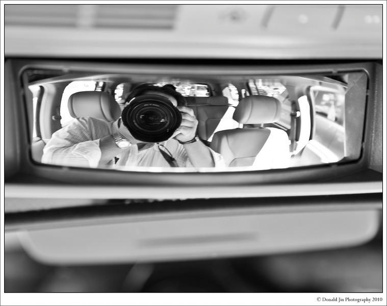 Day 32: Self Portrait 2<br /> I got bored waiting for Kate to come out of the supermarket. Fortunately, I had my favorite toy with me. This SUV comes equipped with what's called a conversation mirror. It's a small convex mirror located above the rear view mirror that folds down giving the driver a fish eye view of the back seats. This allows the driver to see everyone in the back and hold conversations while driving.  There's a brilliant idea.  In other words, it's completely useless and I never found the true use for it until today.