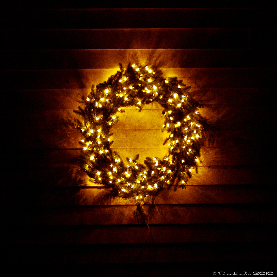 Day 115:  Christmas Lights<br /> I'm putting up just one lighted wreath this year, that's it.  No wrapping tree trunks with lights, no web of lights over the bushes, none of that stuff.  It will be just one wreath lit to signal the coming of Christmas.  I guess I'm getting old and lazy.