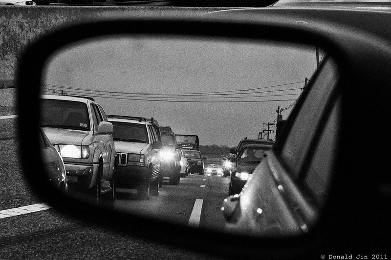 Day 218: The Commute<br /> My commute to work is about an hour each way.  Let's see... that's 2 hours a day, 10 hours a week, 40 hours a month and 480 hours a year.  Assuming an 8 hour work day, that's 60 days out of the year, I'm spending inside my car, just commuting.  If I was earning minimum wage, the opportunity cost of my commute would be about $3,840 a year.  Three times minimum wage would be close to $12,000 a year, four times minimum wage would be $15,000…  These are the thoughts going through my head as I sit in traffic everyday.