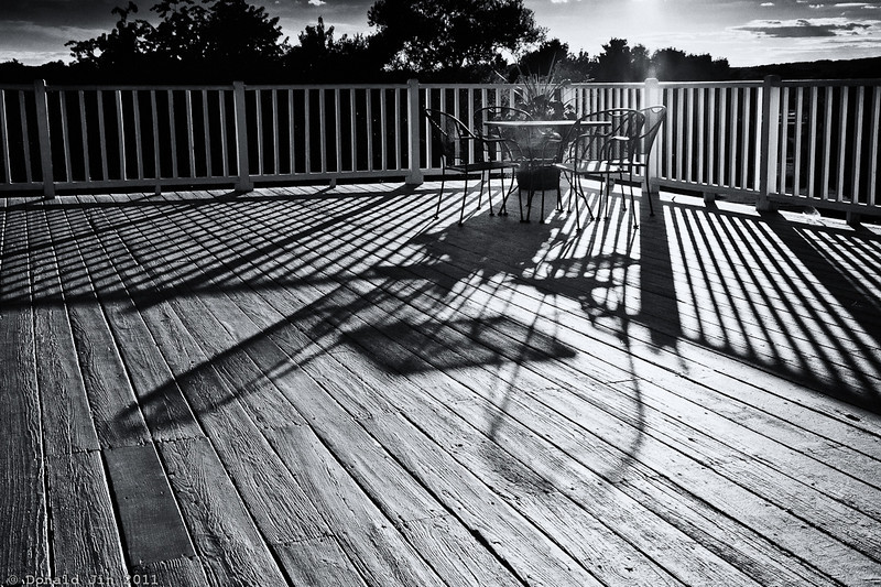 Day 356: Shadows at Play<br /> Great round of golf today at the Sandy Burr CC.  The weather was beautiful, the course was empty and my putts were going in for a change.  I wish there were more days like this.<br /> After my round, I stepped out to the deck of the club house to enjoy the sunset and I was struck by these shadows at play.