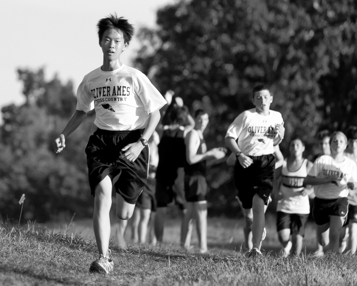 """Day 34: Personal Best<br /> Alex ran in his first race as a freshman member of the Oliver Ames HS Cross Country Team today.  He didn't take first place or break any records, but it really didn't matter at all.  It was so heartwarming to see the camaraderie he shared with his teammates and even among the opposing high school runners.  On the way home, I asked Alex whether he held back for any reason.  He said """"no dad, I gave everything I got from start to finish."""" I said """"that's good.""""  I was very proud of him today."""