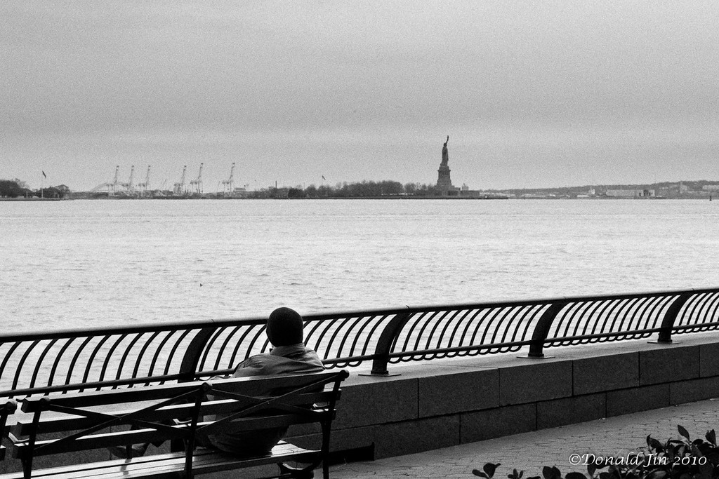 Day 143: On Christmas Day<br /> Lady Liberty watches over the island as a solitary man watches over her, all on a Christmas day.