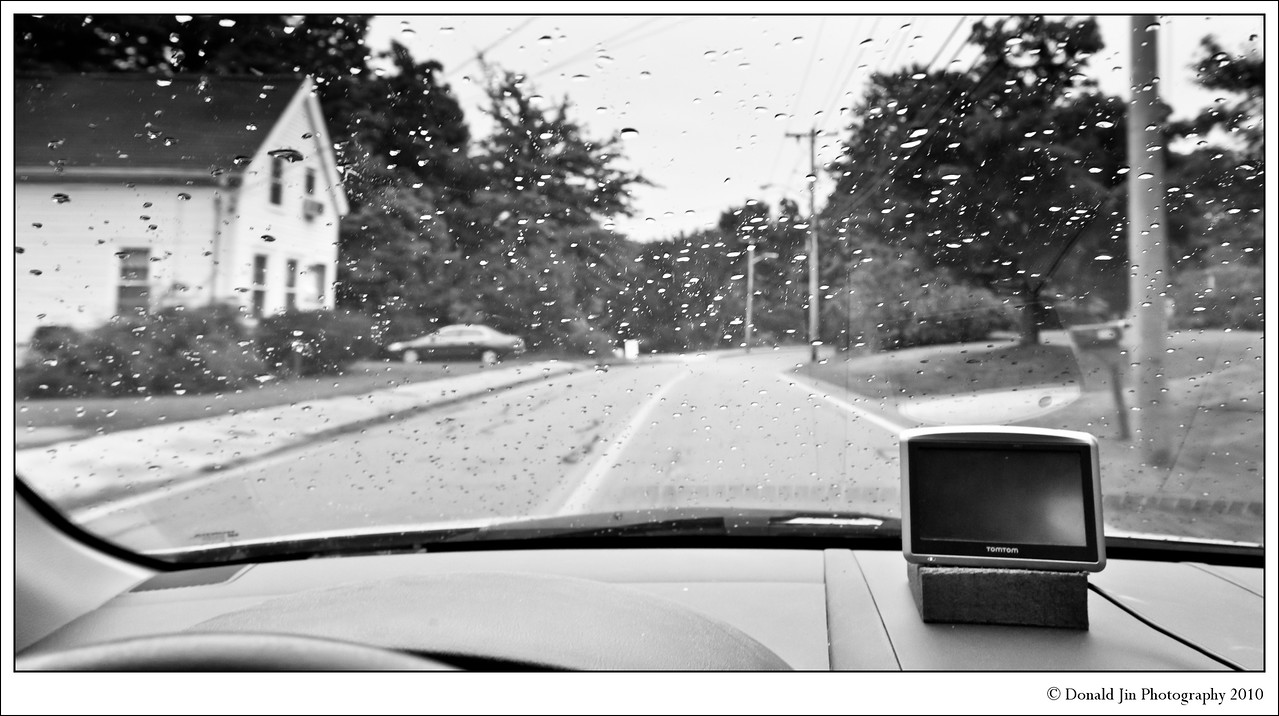 Day 18: Down Lincoln Street<br /> It is a gray, gloomy, wet Sunday afternoon. After the Sunday service, Alex had a Patrol Leader Committee (PLC) meeting at the scoutmaster's house. Completely lost for today's photo, I decided to take a photo while driving to pick up Alex. Not a very smart thing to do, but there weren't any cars around and it looked pretty safe.  I didn't think I would end up using this shot but after looking at it for a while, the photo grew on me. I tend to favor this type of photos.  As mundane as it may be, it's a true slice of life.  The drizzling rain on the windshield and the subdued tone of the surrounding captures the air of melancholy that was in the car.