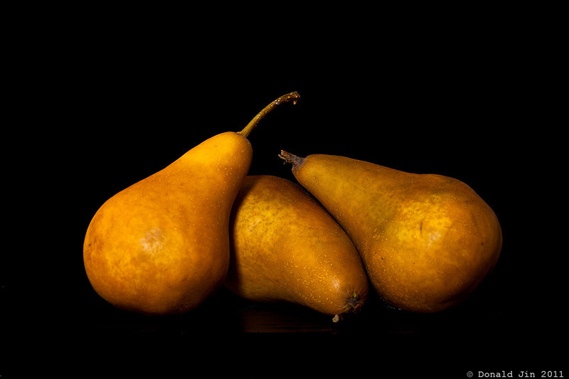 Day 287: Three Pears <br /> I'm realizing any object when placed in front of a black background with some nice lighting will look pretty decent.  I do like the way I arranged the pears here.