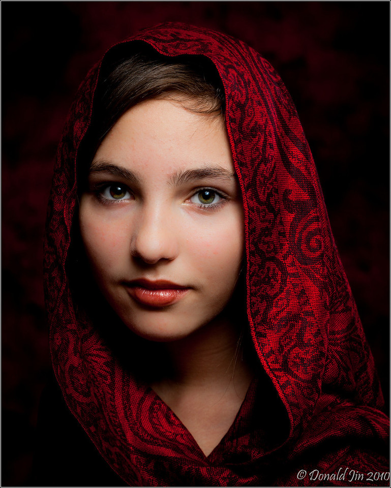 Day 76: A Girl with a Red Scarf<br /> This is my favorite image from tonight's photo shoot.  The deep crimson scarf gives the image a classic vintage look while Shalaina's soulful eyes draws the viewer right into the photo.