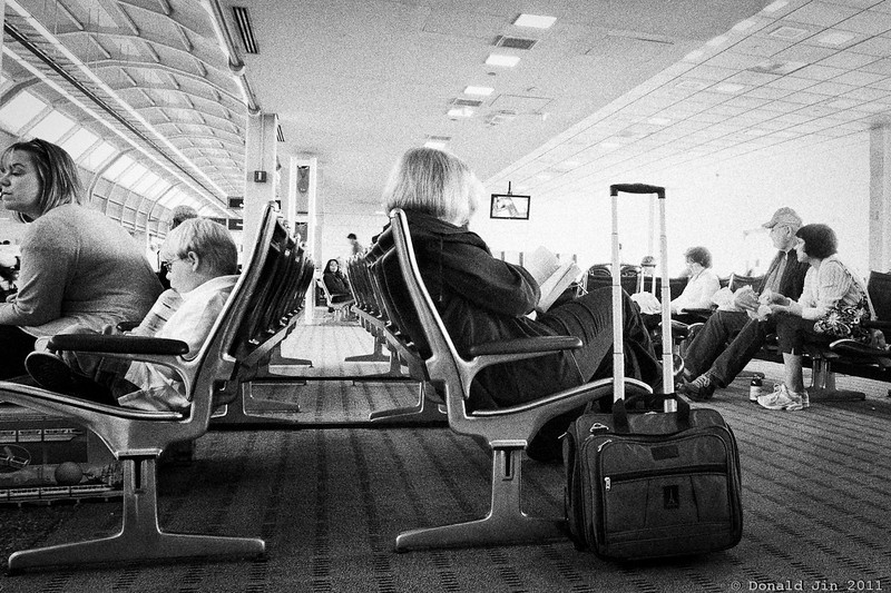 Day 261: At the Airport<br /> We left Orlando this morning and headed back to Boston via Washington DC.  We had couple of hours to kill in DC between flights.  Airport is a great place to observe people and capture candid moments.