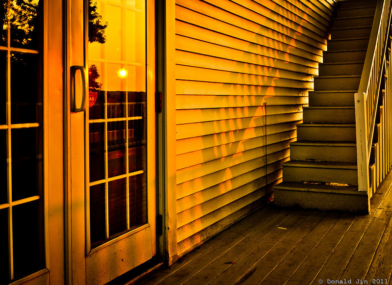 Day 348: Stairway into Sunset<br /> Evening sun hitting the side of the club house at the Sandy Burr Country Club.