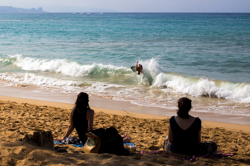 Surfer at Baldwin Beach in Maui, Hawaii