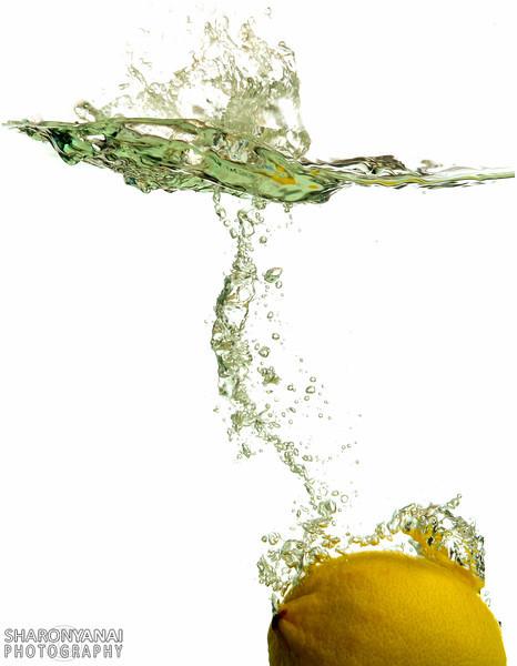 Lemon falling to the water