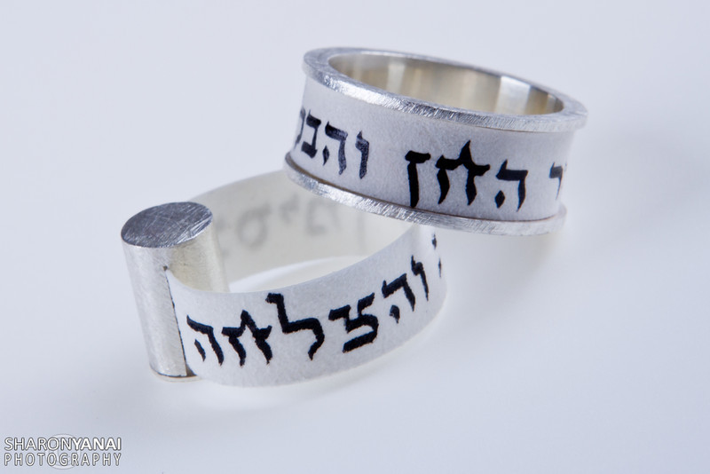 Ring of white and silver with Hebrew letters for luck and success