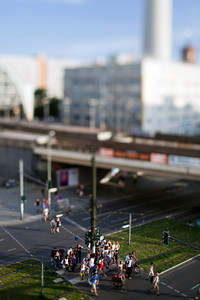 People crossing Karl Liebknecht street in front of Alexanderplatz station, Berlin, Germany. Tilted lens used for shallow depth of field.