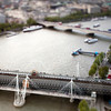 Aerial view of Hungerford bridge over the Thames river, with Waterloo bridge on the background. London, England, United Kingdom.Tilted lens used for shallow depth of field.