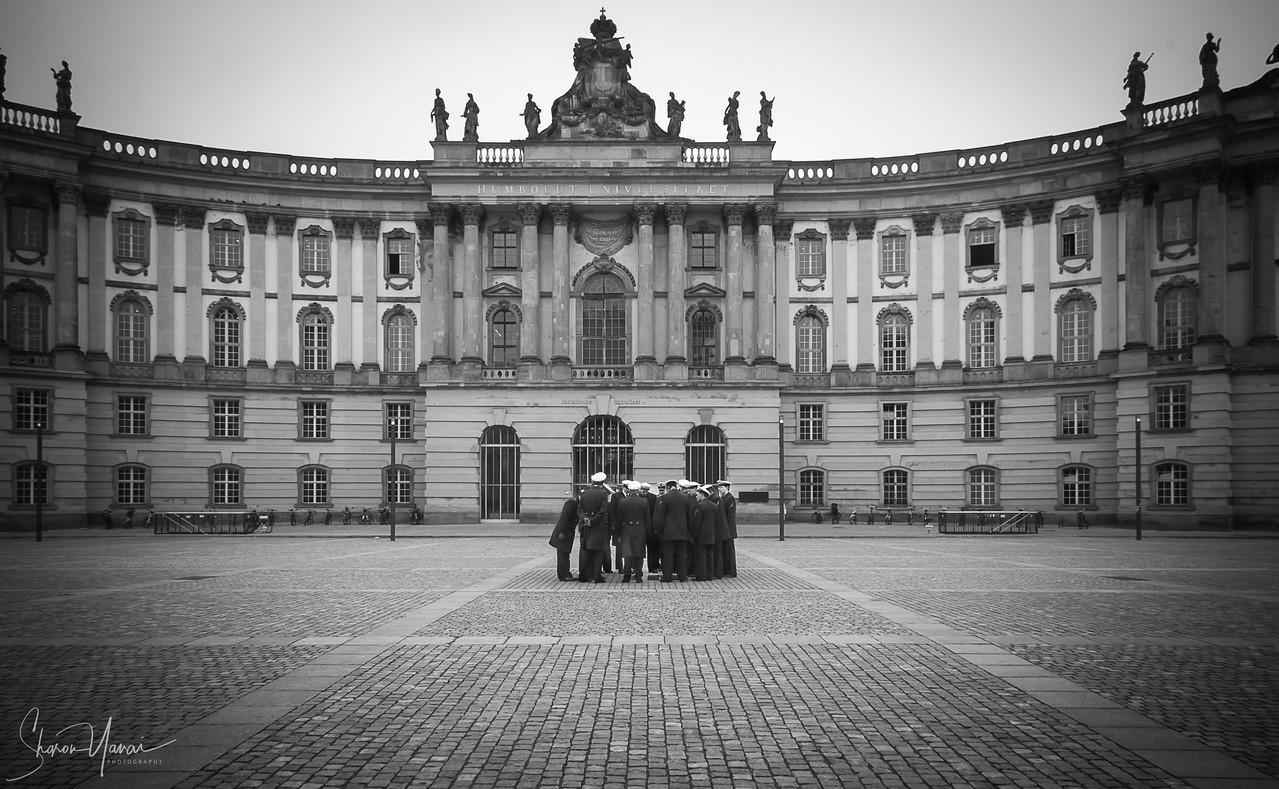 Group of German soldiers looking at the Micha Ullman memorial of the book burning set, Bebelplatz (Opernplatz), Berlin, Germany