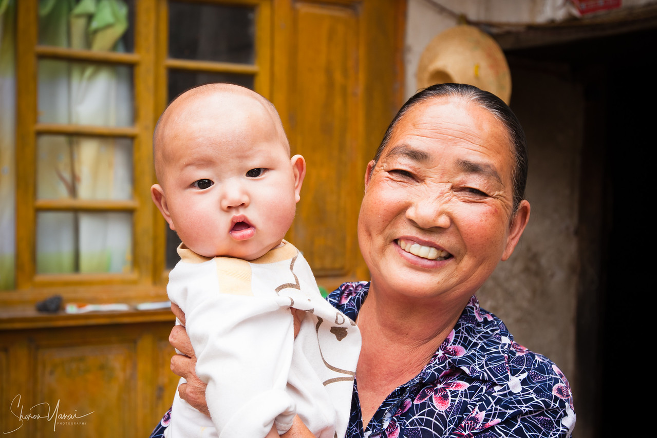 Grandmother and her Grandson, Villagers, Yunnan, China