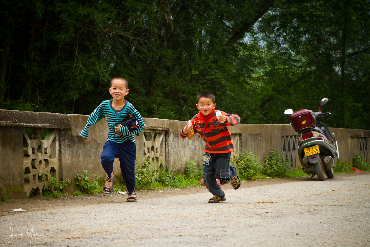 Kids Running Over The Bridge, Yangshuo, China