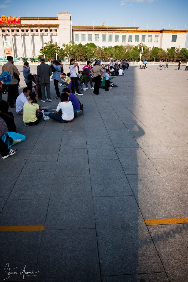 Chinese waiting in the shade, Tian'anmen Square, Beijing, China