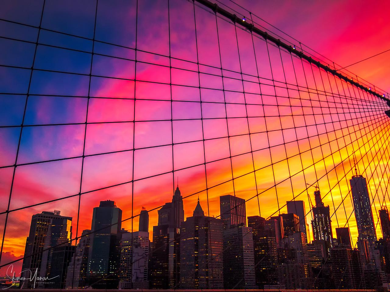 View of Manhattan at sunset from Brooklyn Bridge