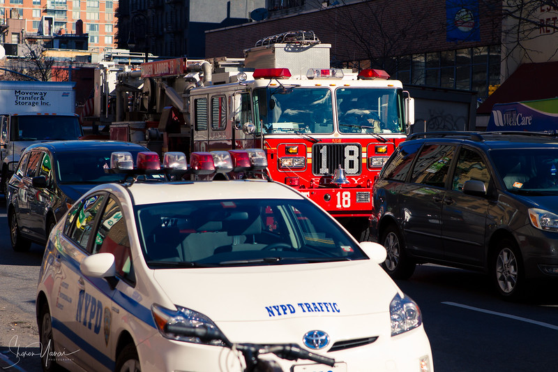 NYPD car and firefighters car, Manhattan, NY, USA