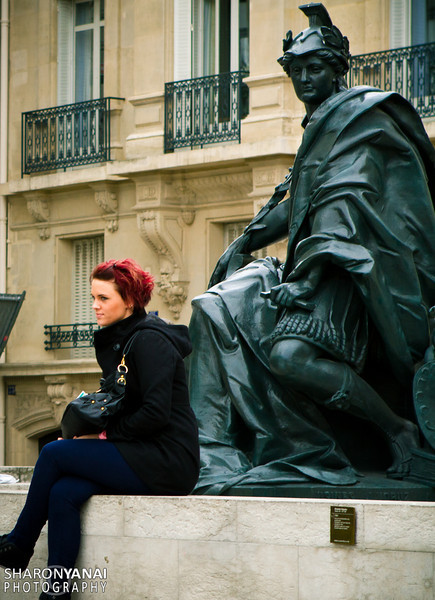 Sitting like the statue, Paris, France