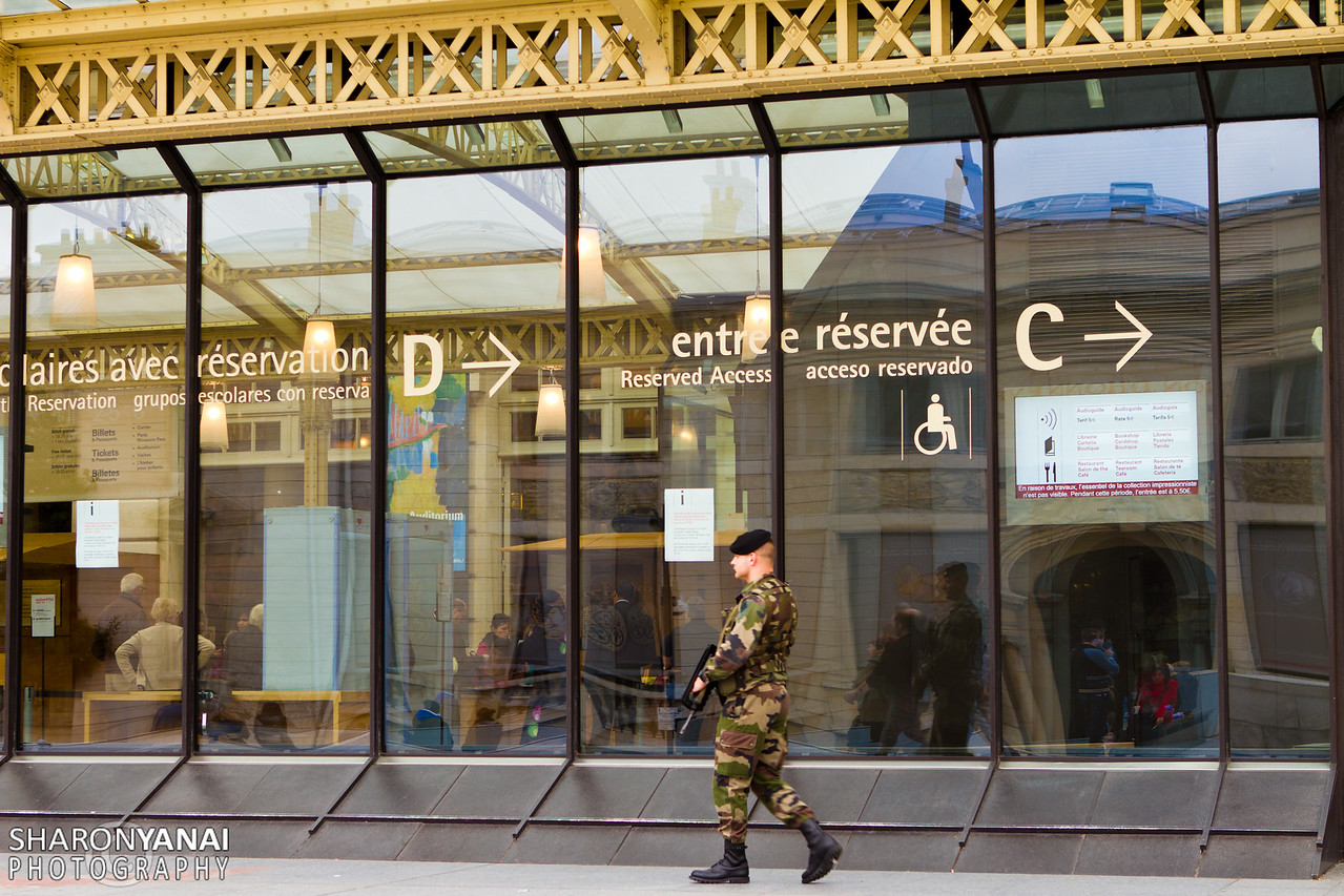 Guard at the entrance to the Orsay Museum (Musée d'Orsay), Paris, France
