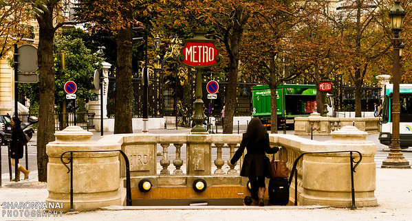 woman enters the Metro station, Paris, France
