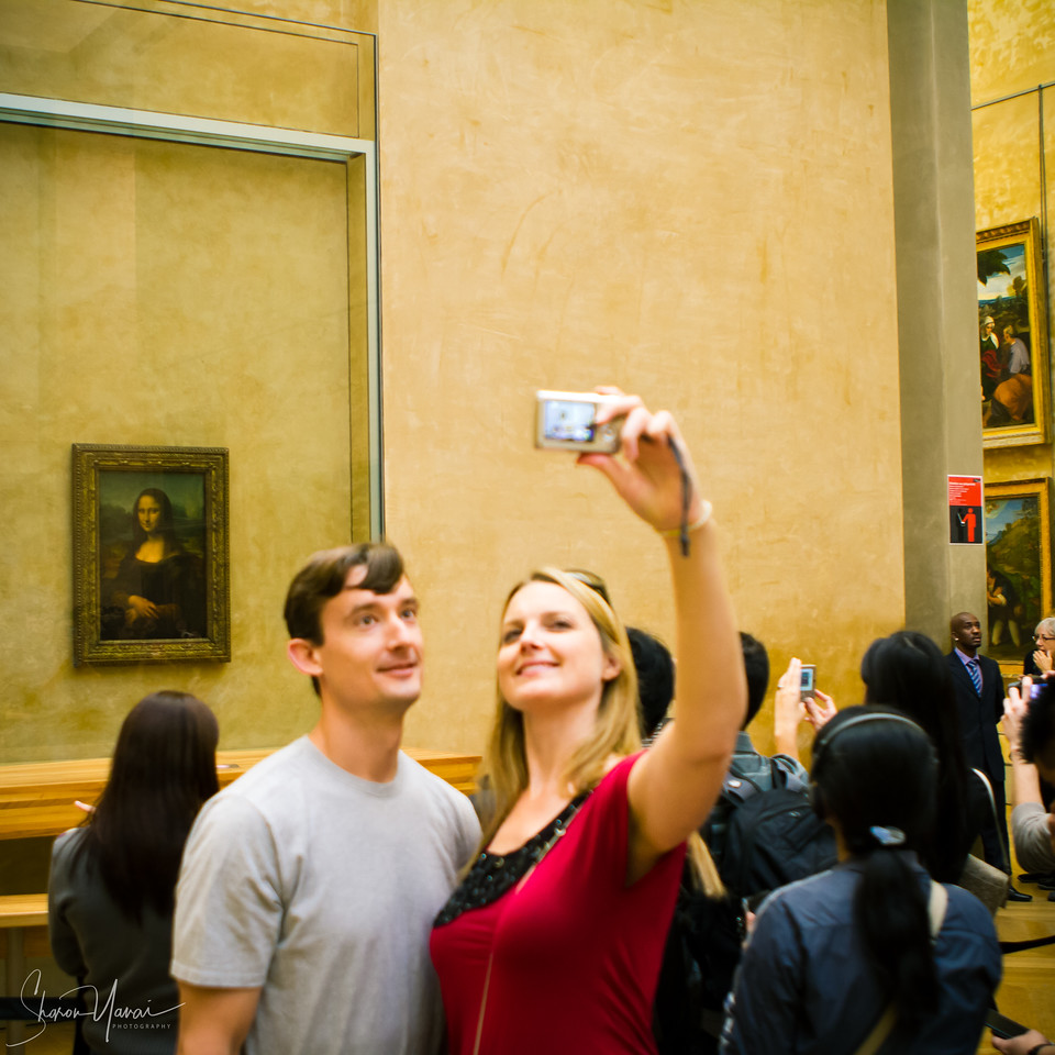 Taking photos with Mona Lisa at the Louvre, Paris, France