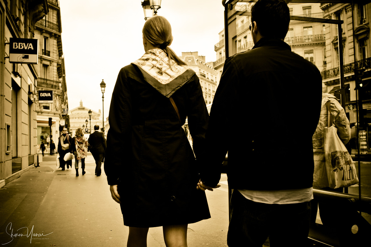 Couple on the streets of Paris, Paris, France