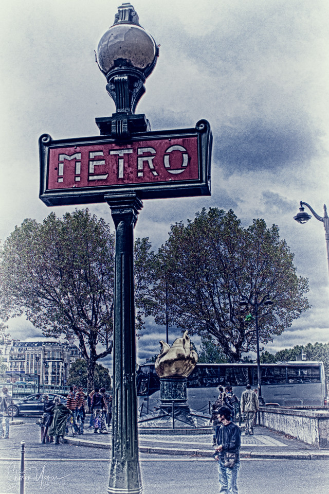 Surreal look of the famous Metro sign, Paris, France