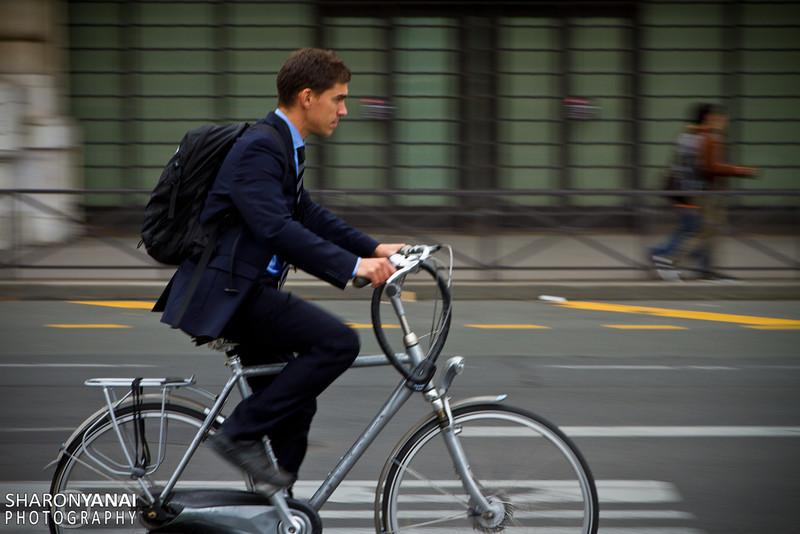 Suit on bike, Paris, France
