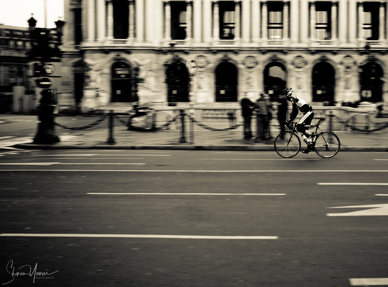 Riding sports bike in front of the Opera House, Paris, France