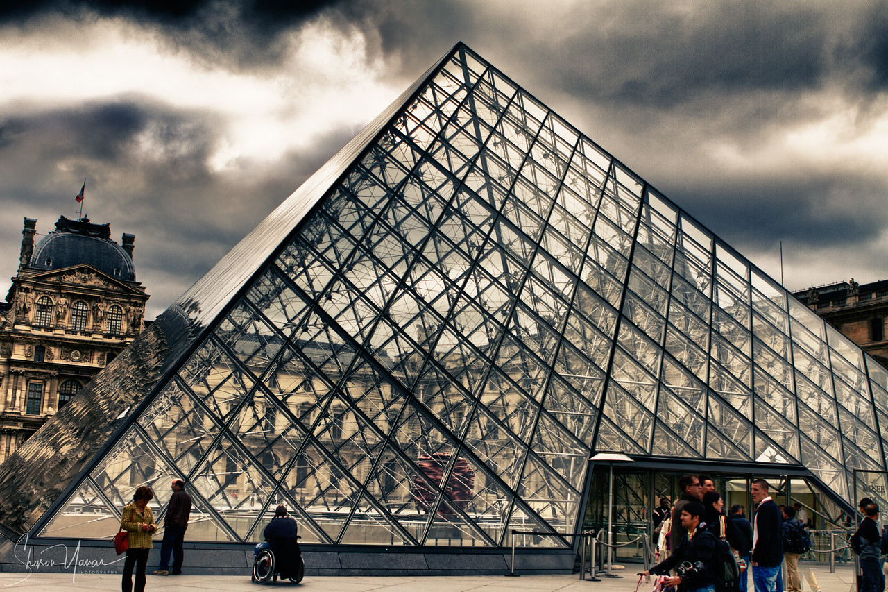 The glass pyramid at the entrance to the Louvre, Paris, France