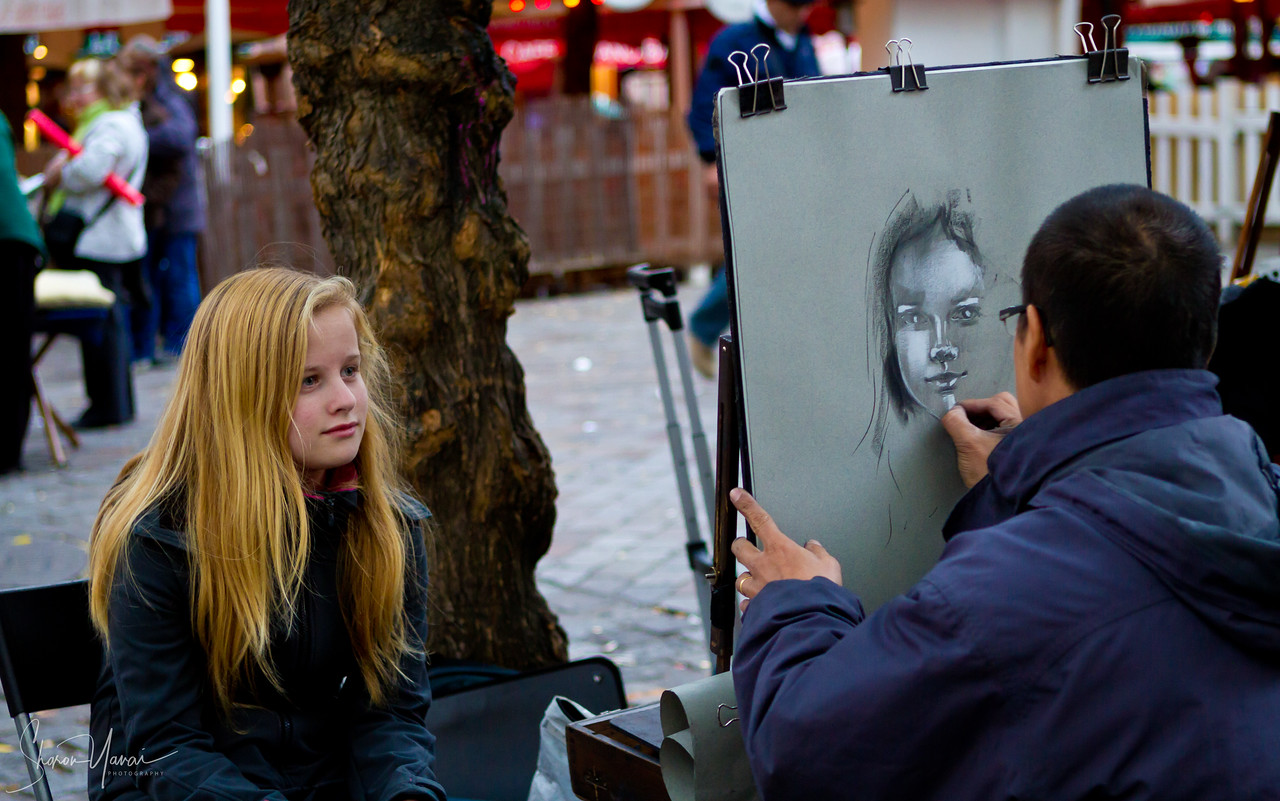 Painting a blond girl at the Montmartre, Paris, France