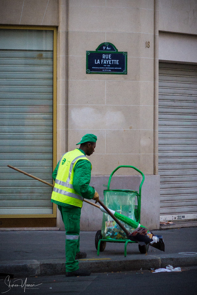 Cleaning worker, Rue La Fayette, Paris, France