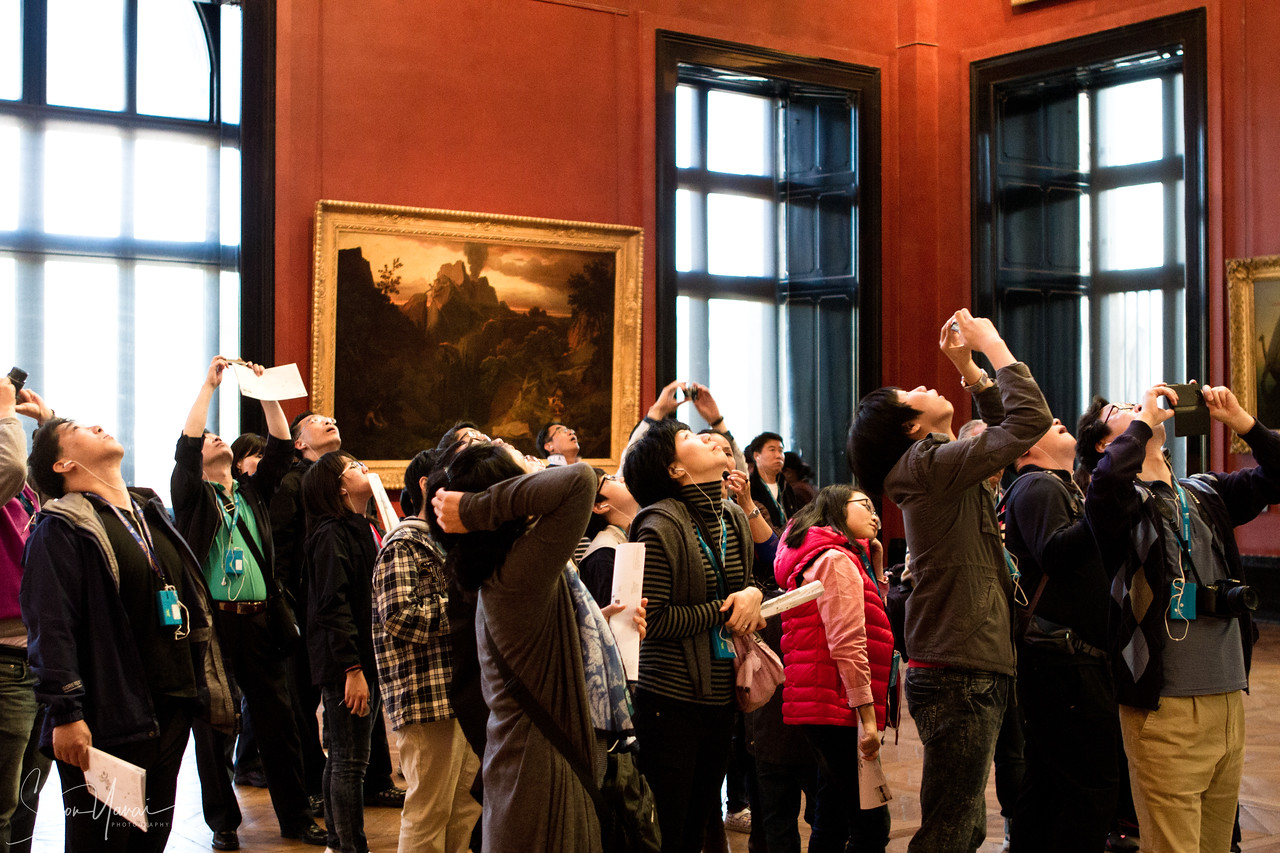 Group of people inside the Louvre, Paris, France