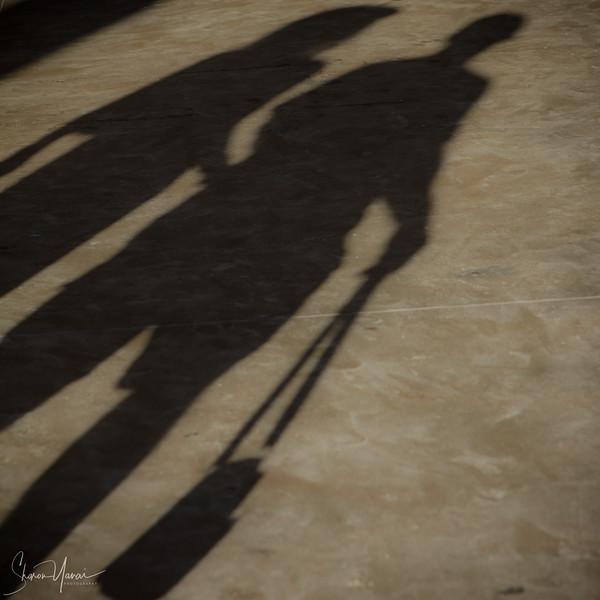 Shadows of walking people