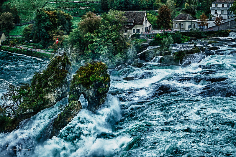 Swiss flag on the rocks of the Rhine falls, Switzerland HDR