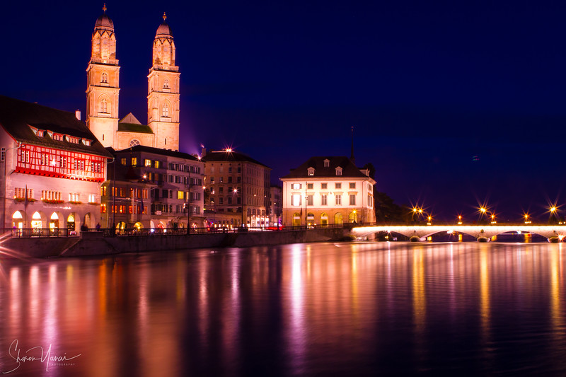 Zurich, Switzerland - the famous cathedral and the bridge with lights at night