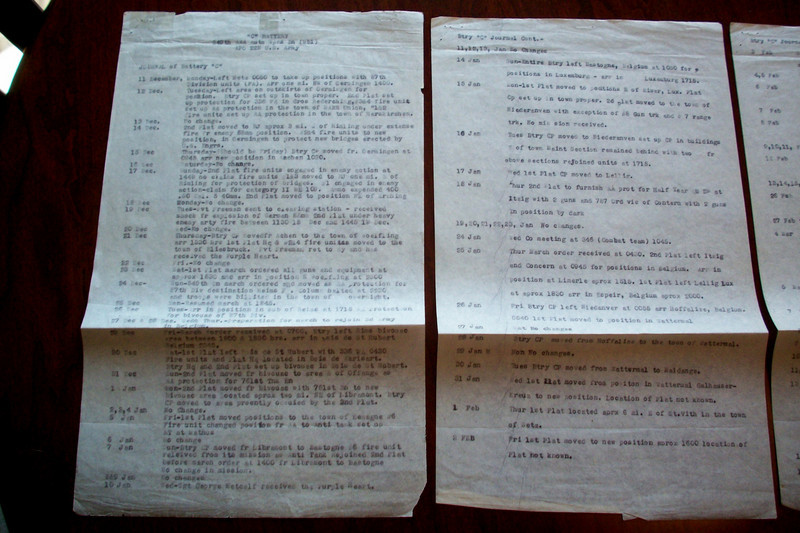 """Pages of 549th AAA AW Bn- Btry C Journal giving time line of unit - WWII.<br /> <br /> Photo contributed by Charles Craig- stepson of<br />  1st Sgt Oliver Santangelo who served in this unit.<br /> <br /> Email from Charles Craig - <br /> """"Ollie was the 1st Sgt.. <br /> He was the one who had the company clerk do the daily journal. <br /> It was his responsibility for that to happen.<br /> Don't know why but it is on onion skin paper, but it's legal size paper..<br /> ====<br /> <br /> Can you believe it!! <br /> Through placing request for any information/photos about the <br /> 549th AAA AW BN - Btry C,<br /> just look at all the items that many have contributed after finding us here....<br /> <br /> I now have this great find - the daily journal kept to show my Dad, <br /> who wanted to know about his brother, Mel's time/place <br /> during the Battle of the Bulge.. <br /> <br /> And it all started in 2004 with Tim Muilenburg, <br /> Son of Ivan Muilenburg contributing the unit photo.. <br /> <br /> Here's to the great soldiers of the 549th AAA AW Bn Btry C,<br /> and also to the family members of those men who are making sure their <br /> time/place in the war will be documented for generations to come."""