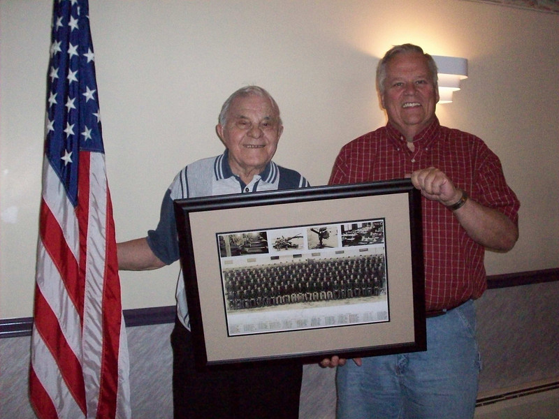 "1st Sgt Oliver Santangelo and his stepson, Charles Craig<br /> Memorial Day - 2009. <br /> <br /> He served in the 549th AAA AW BN - Btry C. - WWII<br /> <br /> <br /> Update May – 2009<br /> Another contact from this unit!!<br /> 1st Sgt Oliver Santangelo<br /> drafted on 12/01/1941 in Canton Ohio.<br /> <br /> An email from his stepson, Charlie Craig:<br /> My daughter and I had a recent conversation with my step dad. <br /> He showed us his Army discharge papers and we wrote down his unit number. <br /> To our surprise we found his pic on that 87th site. <br /> He is Oliver Santangelo. <br /> He is 1st. row 7th from the left. <br /> We bought the picture and are having it framed and giving it to him on Memorial day to honor him and the men he served with. <br /> He is 89 and still sharp as a tack. <br /> Thanks,<br /> Charlie<br /> <br /> I replied asking him to send more info which I will place here once I receive it.<br /> I also cropped his photo from the large unit photo and have placed it in the gallery.<br /> Isn't this amazing!<br /> <br /> Update - June 1 - 2009<br /> Email from Mr. Santangelo's stepson, Charles Craig:<br /> <br /> On Memorial Day, we gave Ollie (Mr. Oliver Santangelo) the framed photo <br /> of the 549th AAA unit – Btry C. <br /> He was shocked and really touched that we were able to find it. <br /> <br /> I did ask him about the names you gave – <br /> He remembers Mr. Luedke.<br /> He said that during training at Camp Davis, <br /> he and Mr. Luedke had to escort the body of a young man back home. <br /> The soldier had accidentally killed himself while cleaning his rifle.<br /> <br /> He could not recall where they were for the early part of December of 44,<br /> But claims that the 549Th was in Bastogne during the Battle of the Bulge. <br /> Ollie says that they couldn't get air cover for 4 days due to the weather.<br /> <br /> Ollie and my Mom attended a reunion in St. Louis/Bran son, but he couldn't recall what year.<br /> I will ask him about more of his memories when I see him again this week.<br /> <br /> We might try to call Mr. Luedke.<br /> <br /> Thanks to you and all of those who have contributed to the site.<br /> <br /> Charlie<br /> <br /> Update - June 5, 2009<br /> Email from Charles Craig - <br /> ""Ollie was the 1st Sargent. He was the one who had the company clerk do the daily journal. It was his responsibility for that to happen.<br /> Don't know why but it is on onion skin paper, but it's legal size paper.. <br /> He has had the journal since he left the Army.<br /> Ollie did engage in combat and tells of being in the foxholes freezing.<br /> He actually came face to face with Patton who called Ollie a ""son of a bitch"" Ollie isn't happy to be called that, but he has great respect for Patton.""<br /> <br /> Original Unit Journal giving time line!! <br /> Thanks to Oliver's grandaughter, Katie, who typed this journal out since it was hard to read original.<br /> <br /> Charles has passed on from Mr. Santangelo other memories and photos which now has given this unit enough history collected that I have asked webmaster to add this unit under link of ""our History"" so I can place all items.<br /> <br /> As a side note - several have photos of the horrors they saw when they went into the concentation camps after they were liberated.<br /> At this point - I have deferred for now placing them here.<br /> Do know, the men who wtinessed these atrocities want to make it clearly understood - - <br /> it was real....and it was horrible."