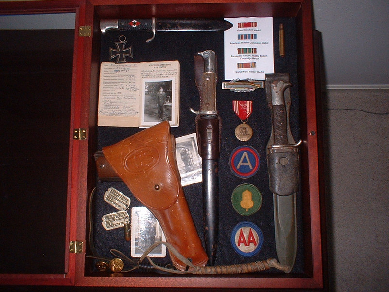 This is a shadow box that Tim Muilenburg put together in dedication of his Father's collection of items pertaining to his service in WWII. <br /> <br /> Cpl Ivan Muilenburg proudly served in the 549th AAA AW BN - Btry C.<br /> <br /> His son, Tim Muilenburg, is searching for anyone who may have known his father during the war, or is interested in sharing their stories about serving in the 549th AAA AW, or anyone that had their family member serve with this unit. <br /> <br /> My Uncle, Melvin Amelung, also served in this unit.<br /> <br /> Please make contact if you are connected in any way to any of these names shown in the gallery of names of the <br /> 549th AAA AW BN BTRY C.<br /> <br /> 549th AAA AW BN BTRY C<br /> 87th Infantry Division.<br /> Involved in the Battle Of The Bulge - WWII.