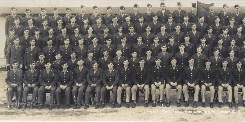 549th AAA AW BN BTRY C - partial group pic.<br /> <br /> Picture dated - October - 1943<br /> <br /> Looking at pic - this is left half of large group pic in this gallery.<br /> <br /> Photo contributed by Tim Muilenburg, <br /> son of Ivan Muilenburg, who served in the 549th.