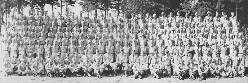 "87th Signal Company - 87th Infantry Division - WWII <br /> <br /> John S. Nelson II was an officer in the 87th Signal Company, responsible for the 87th Signal Company photos.<br /> <br /> Per his son, ""He's the big guy in the center of the first row (seated).""<br /> <br /> His son, John III, also has censor's proofs of many combat and operations photos. <br /> <br /> He also has some interesting memorabilia...<br /> a section of communications cable they removed from behind enemy lines along the Siegfried line, <br /> and a waffen ss sword that he believes came from Buchenwald. <br /> <br /> Per Mr. Nelson's son:<br /> ""Friends, <br /> I have gone to Buchenwald each of the past two years - along with Koblenz, Bastogne, etc - trying to figure out where they really were. <br /> The written records are incomplete and contradictory. <br /> <br /> My dad died long ago after a tough life. <br /> <br /> It would be most helpful to find someone who knew him. <br /> <br /> I went to the 2003 reunion courtesy of Gladwin but no one there knew anyone from the 87th Signal Company. <br /> It also seemed like these were mostly enlisted men and the officers were - well, officers and separate.<br /> <br /> So I could really use some actual details, like how did they get to Buchenwald to take the other photo in this gallery of someone entering the main prisoners gate at Buchenwald, <br /> the concentration camp, on liberation day in April 1945?<br />  <br /> Can anyone help?<br /> <br /> Not many of my materials are scanned as they are in a scrapbook that I have been reluctant to disassemble. <br /> But I could if they would be of real value.<br /> <br /> Thanks in advance for any advice you can give.""<br /> <br /> John S. Nelson III<br /> Son of John S. Nelson II; 87th Signal Company<br /> <br /> Update - June-2007<br /> Notice to Mr. Nelson III,<br /> Please contact me - I have lost your email address! - The 87th Association and many others are requesting to contact you with questions and info. <br /> Please place email here under comment, or email me - <br /> My email can be found on the 87th Infantry Division Associatioin web page:<br />  <a href=""http://www.87thinfantrydivision.com"">http://www.87thinfantrydivision.com</a><br /> <br /> Thank you so much.<br /> Debra H. - gallery moderator"
