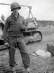 T/4 Arthur William (Bill) Jasper<br /> 312th Engineer Combat Battalion<br /> 87th Infantry Division<br /> WWII<br /> <br /> Standing in front of a bulldozer and holding a German sword.<br /> This was in Germany, probably around April 1945. <br /> <br /> photo submitted by Arthur William (Bill) Jasper