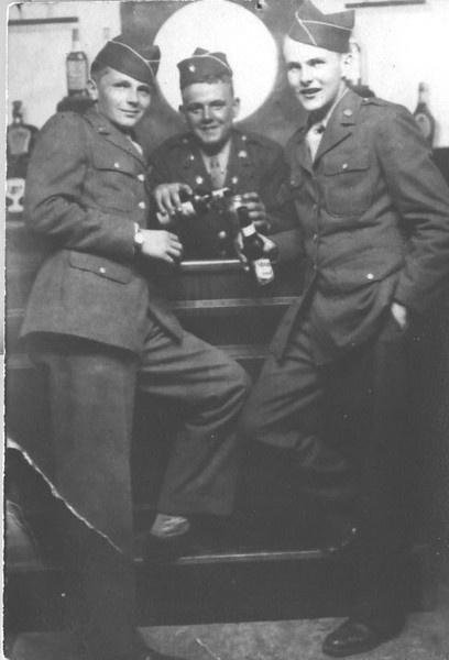 Left to right: John T. Moran, Gordon Skowlund (M-347), Bob Naslund