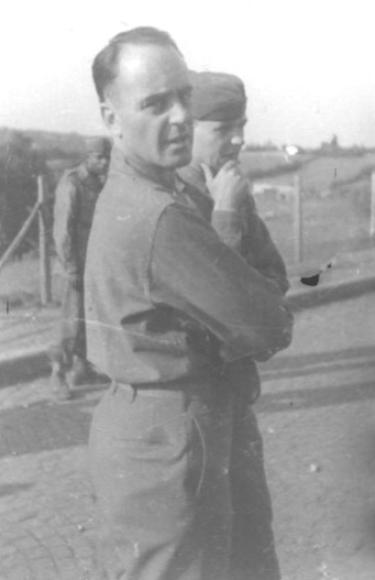 An unidentified officer is on the left, facing the camera.  On the right is 1st Lt. Leroy A. Guest, who was wounded by friendly fire during the final week of the war.